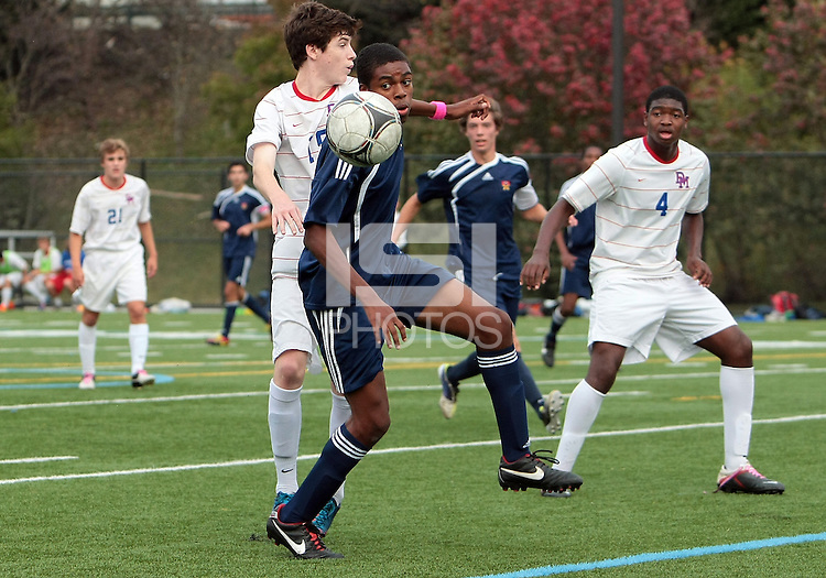 HYATTSVILLE, MD - OCTOBER 26, 2012:  Brendan Burke (25) of DeMatha Catholic High School defends against Azaan Wilbon (15) of St. Albans during a match at Heurich Field in Hyattsville, MD. on October 26. DeMatha won 2-0.