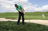 Charl Schwartzel plays his 2nd shot from the rough on the 18th hole in the 3rd Round of the Open de Espana in Madrid...Photo NEWSFILE/Eoin Clarke.(Photo credit should read Eoin Clarke/NEWSFILE)....This Picture has been sent you under the condtions enclosed by:.Newsfile Ltd..The Studio,.Millmount Abbey,.Drogheda,.Co Meath..Ireland..Tel: +353(0)41-9871240.Fax: +353(0)41-9871260.GSM: +353(0)86-2500958.email: pictures@newsfile.ie.www.newsfile.ie.FTP: 193.120.102.198..