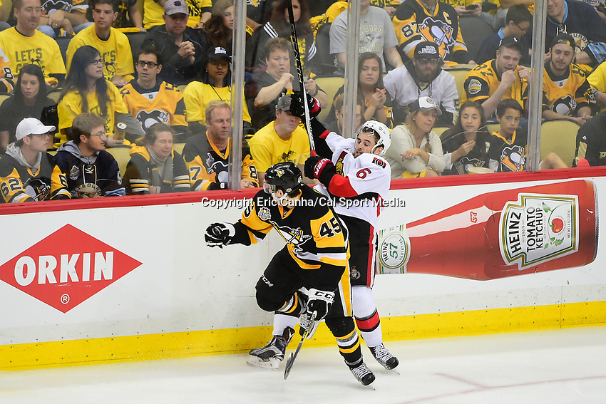 May 21, 2017: Pittsburgh Penguins right wing Josh Archibald (45) checks Ottawa Senators defenseman Chris Wideman (6) during game five of the National Hockey League Eastern Conference Finals between the Ottawa Senators and the Pittsburgh Penguins, held at PPG Paints Arena, in Pittsburgh, PA. Pittsburgh shuts out Ottawa 7-0 to lead the series 3-2.  Eric Canha/CSM