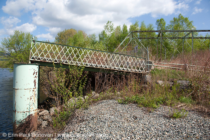Old Meadows Bridge on the side of the Androscoggin River in Shelburne, New Hampshire USA.