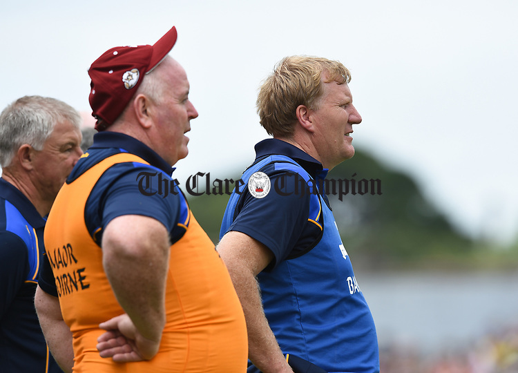 Clare manager Seamus Clancy and coach Tom Newell look on during their Minor Munster final at Killarney.  Photograph by John Kelly.