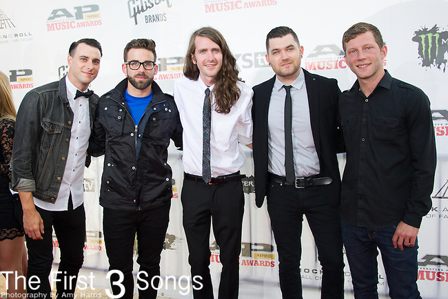 Derek Sanders, Alex Garcia, Brooks Betts, Jeremy Lenzo, and Jake Bundrick of Mayday Parade attend the 2014 AP Music Awards at the Rock And Roll Hall Of Fame and Museum at North Coast Harbor in Cleveland, Ohio.
