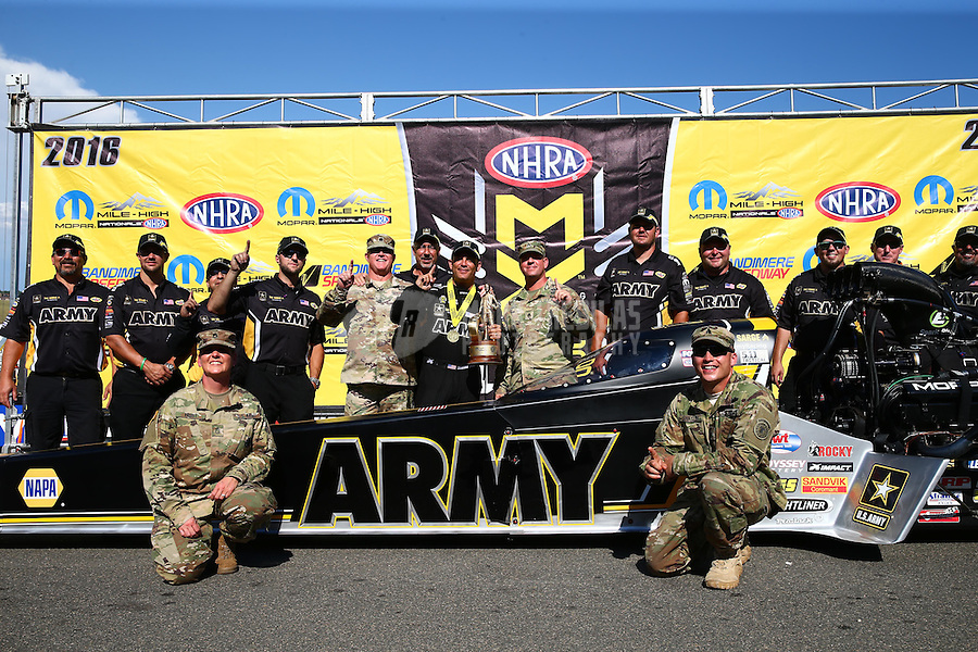 Jul 24, 2016; Morrison, CO, USA; NHRA top fuel driver Tony Schumacher celebrates with US Army soldiers after winning the Mile High Nationals at Bandimere Speedway. Mandatory Credit: Mark J. Rebilas-USA TODAY Sports