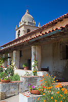 Monterey County, CA<br /> Tower of the Carmel Mission Basilica (1797) above the cloister walk and courtyard gardens - Mission San Carlos Borromeo del Rio Carmelo