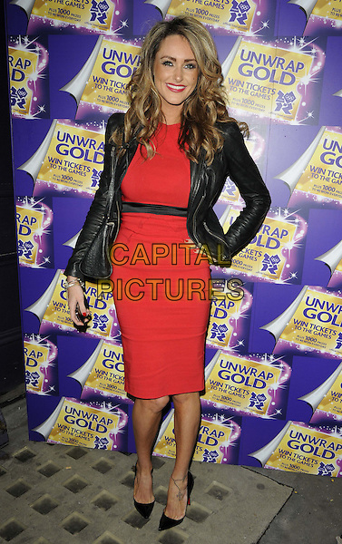 Georgina Dorsett.The Cadbury Unwrap Gold launch party with the chance to win Olympic Games tickets inside the participating bars of Cadbury chocolate, Ninetyeight Bar & Lounge, Morrell House, London, England..April 12th, 2012. full length red dress black leather jacket white striped stripes bag purse hand on hip  .CAP/CAN.©Can Nguyen/Capital Pictures.