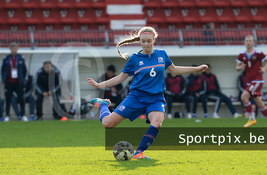 20150406 - MELUN , FRANCE  : Icelandic Andrea Hauksdottir (right) pictured in action during the soccer match between Women Under 19 teams of Iceland and Russia , on the second matchday in group 3 of the UEFA Elite Round Women Under 19 at Stade Municipal , Melun , France . Monday 6th April 2015 . PHOTO DAVID CATRY