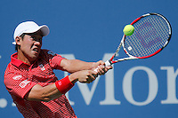 Kei Nishikori of Japan returns a shot against Novak Djokovic of Serbia during men semifinal match at the US Open 2014 tennis tournament in the USTA Billie Jean King National Center, New York.  09.05.2014. VIEWpress