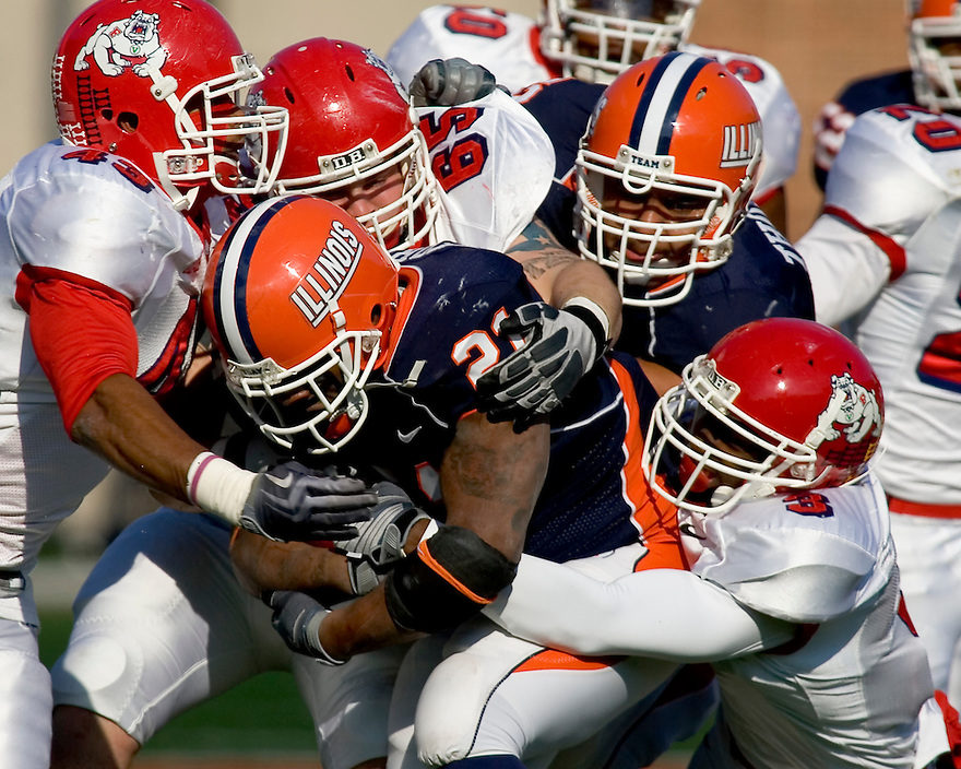 December 5, 2009 - Champaign, Illinois, USA -  Fresno State defenders Chris Carter (43), Chase McEntee (65), and Moses Harris (3) tackle Illinois running back Jason Ford (21) in the game between the University of Illinois and Fresno State at Memorial Stadium in Champaign, Illinois.  Fresno State defeated Illinois 53 to 52..
