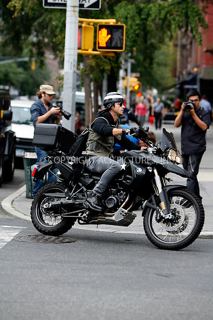 WWW.ACEPIXS.COM . . . . .  ....September 22 2011, New York City....Justin Theroux rifes his motorbike in the West Village on September 22 2011 in New York City....Please byline: CURTIS MEANS - ACE PICTURES.... *** ***..Ace Pictures, Inc:  ..Philip Vaughan (212) 243-8787 or (646) 679 0430..e-mail: info@acepixs.com..web: http://www.acepixs.com