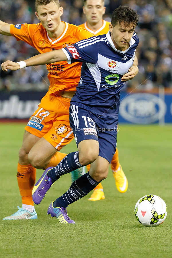 Daniel GEORGIEVSKI of the Victory is fouled in the round seven match between Melbourne Victory and Brisbane Roar in the Australian Hyundai A-League 2014-15 season at Etihad Stadium, Melbourne, Australia.