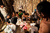 PHILIPPINES, Palawan, Barangay region, a man divides up rice for the families living in Kalakwasan Village