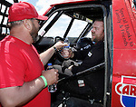 STURGIS, SD - JUNE 13: Justin Berg gets a drink from his dad Steve after the Stock-Mod class during the Liberty Super stores/Dakota Customs 250 short course baja race at the Buffalo Chip.  (Photo by Dick Carlson/Inertia)