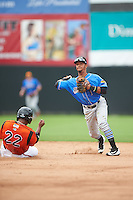 Akron RubberDucks shortstop Ivan Castillo (1) throws to first base as Quincy Latimore (22) slides into second during the first game of a doubleheader against the Bowie Baysox on June 5, 2016 at Prince George's Stadium in Bowie, Maryland.  Bowie defeated Akron 6-0.  (Mike Janes/Four Seam Images)