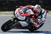 Michel Fabrizio (ITA) riding the Aprilia RSV4 1000 Factory (84) of the Red Devils Roma team rounds turn 11 during a practise session on day two of round one of the 2013 FIM World Superbike Championship at Phillip Island, Australia.