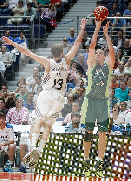 Real Madrid's Sergio Rodriguez (l) and Unicaja's Carlos Suarez during Liga Endesa ACB Semifinal match.June 6,2014. (ALTERPHOTOS/Acero)