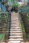 People climbing steps of stone staircase to the rock palace at Sigiriya, Central Province, Sri Lanka, Asia