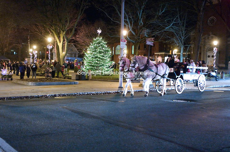Naugatuck, CT- 07 December 2015-120715CM03- A horse drawn carriage from Allegra Farm, East Haddam, CT takes folks around downtown during a tree lighting on the Naugatuck Green on Monday.      Christopher Massa Republican-American
