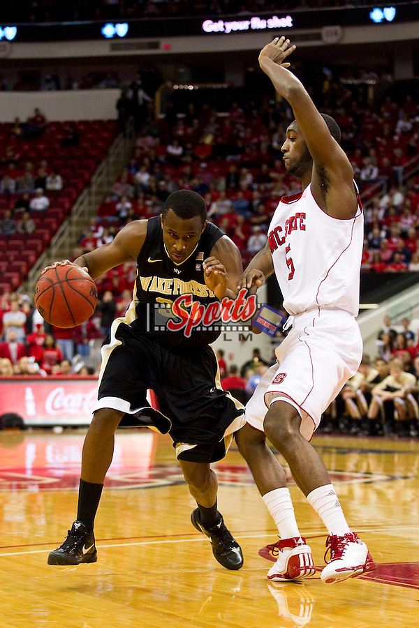 Travis McKie #30 of the Wake Forest Demon Deacons drives the lane past C.J. Leslie #5 of the North Carolina State Wolfpack at the RBC Center on January 8, 2011 in Raleigh, North Carolina.  The Wolfpack defeated the Demon Deacons 90-69.  Photo by Brian Westerholt / Sports On Film