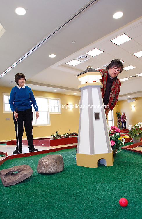 Woodbury, CT-15, February 2010-021510CM07    Renate Tryon (right) peaks around the lighthouse to see where her ball was hit at the 2nd Annual Indoor Miniature Golf Open at the Woodbury Senior Center Monday afternoon.  Although out of good fun, she lost to Betty Ashmore (left) during their match-up.  Tryon owes Ashmore a hot chocolate per their bet.       --Christopher Massa Republican-American