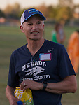 Tim Minor watches as the Nevada Men's Cross Country team competes for the first time in 25 years in the Bonanza Casino Nevada Twilight Classic season opener at Mira Loma Park in Reno on Friday night, August 30, 2019.