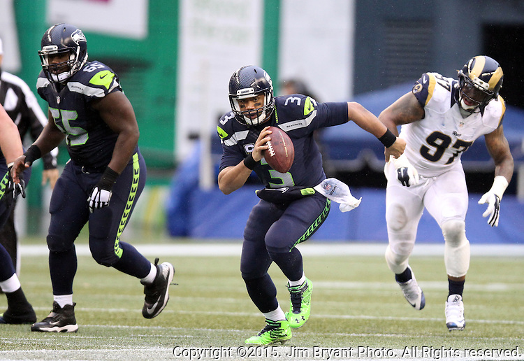 Seattle Seahawks quarterback Russell Wilson (3) scrambles against the St. Louis Rams at CenturyLink Field in Seattle, Washington on December 27, 2015.  The Rams beat the Seahawks 23-17.      ©2015. Jim Bryant Photo. All Rights Reserved