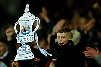 3rd March 2020; The Hawthorns, West Bromwich, West Midlands, England; English FA Cup Football, West Bromwich Albion versus Newcastle United; A young Newcastle United fan celebrates with a foil cutout FA Cup
