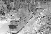 D&amp;RGW caboose #0540 and several cars shown as #478 takes water at Needleton water tank.<br /> D&amp;RGW  Needleton, CO  Taken by Dunscomb, Guy L. - 5/5/1942