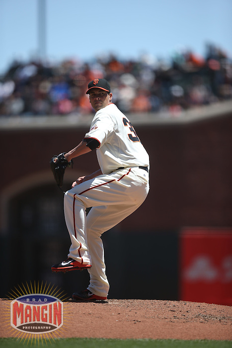 SAN FRANCISCO, CA - MAY 18:  Ryan Vogelsong #32 of the San Francisco Giants pitches against the Miami Marlins during the game at AT&T Park on Sunday, May 18, 2014 in San Francisco, California. Photo by Brad Mangin
