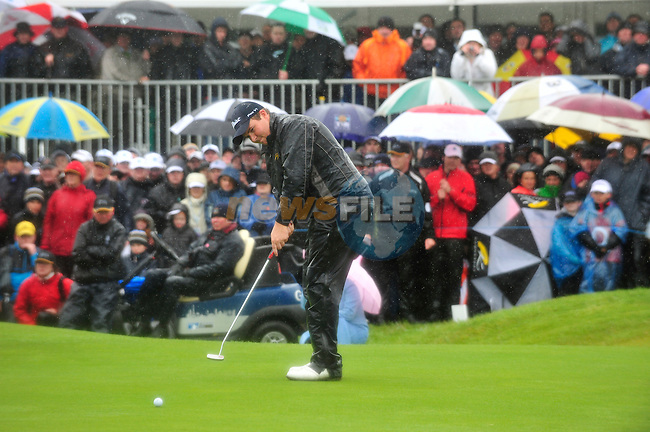 Shane Lowry putts for is 4th shot on the 18th green during the 3rd playoff  hole of the Final Round of the 3 Irish Open on 17th May 2009 (Photo by Eoin Clarke/GOLFFILE)