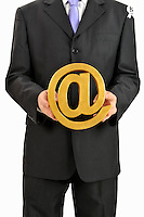 Businessman holding At Symbol in hands (Licence this image exclusively with Getty: http://www.gettyimages.com/detail/106421915 )