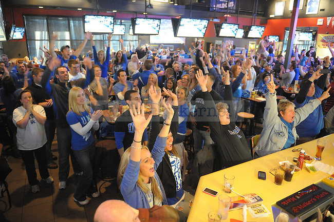 UK fans celebrate UK Men's basketball victory over the University of North Carolina at Buffalo Wild Wings in Lexington, Ky., on 3/27/11. . Photo by Mike Weaver | Staff