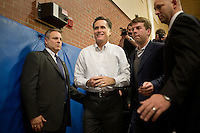 Security guide Mitt Romney out of a campaign event in the overflow area in a gymnasium at a Romney town hall campaign event at McKelvie Intermediate School in Bedford, New Hampshire, on Jan. 9, 2012.  Romney is seeking the 2012 Republican presidential nomination.