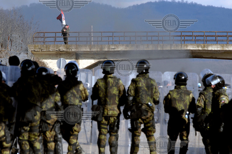 A lone Serbian demonstrator on a bridge in the neutral zone between Kosovo and Serbia. Serbian demonstrators, including Army reservists who fought in the Kosovo war, approached the Kosovo border after marching from the town of Kursumlija in Serbia. Kosovar Albanian riot police held them back, and the crowd burnt tires and threw stones and bricks at the police line. Ethnic tensions were high, just days after Kosovo declared independence.