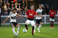 Aron Davies of Fulham U23's kicks the ball upfield as Manchester United's James Garner tries to intervene during Fulham Under-23 vs Manchester United Under-23, Premier League 2 Football at Motspur Park on 10th August 2018
