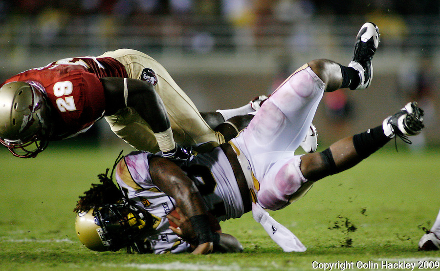 TALLAHASSEE, FL 10/10/09-FSU-Ga. Tech FB09 CH46-Florida State's Kendall Smith sends Georgia Tech's  Anthony Allen to the turf during second half action Saturday at Doak Campbell Stadium in Tallahassee. The Seminoles lost to the Yellow Jackets 49-44..COLIN HACKLEY PHOTO