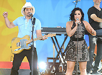 NEW YORK, NY - June 24 : Demi Lovato joins Brad Paisley on stage as they  perform in Central Field at Rumsey Playfield as part of the Good Morning America Summer Concert Series on June 24 in New York City.<br />  Photo Credit:John Palmer/MediaPunch
