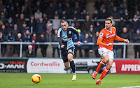 Oliver Lee of Luton Town hits the ball away from Michael Harriman of Wycombe Wanderers during the Sky Bet League 2 match between Wycombe Wanderers and Luton Town at Adams Park, High Wycombe, England on 6 February 2016. Photo by Andy Rowland.