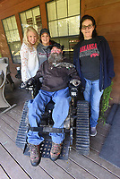 NWA Democrat-Gazette/FLIP PUTTHOFF <br /> A motorized chair gets Steve Swope into the woods or wherever he wants to go. With Swope are state ALS director Jennifer Necessary (from left), Swope's wife Jackie, and his mom Alma Swope.