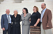 Washington, DC - September 8, 2009 -- Associate Supreme Court Justice Sonia Sotomayor  and her family share a laugh as they pose for photographers following the investiture ceremony in her honor at the United States Supreme Court in Washington, D.C. on Tuesday, September 8, 2009.  From left to right: Mr. Omar Lopez, Stepfather; Mrs. Celina Sotomayor, Mother; Mrs. Tracey Sotomayor, Sister-in-law; and Dr. Juan Sotomayor, Brother..Credit: Ron Sachs / CNP