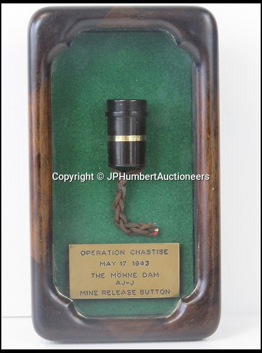BNPS.co.uk (01202 558833)<br /> Pic: JPHumbertAuctioneers/BNPS<br /> <br /> The bomb release button which launched the famous 'bouncing bomb' that destroyed a German dam during the legendary Dambusters raid has sold for more than £40,000.<br /> <br /> This device was triggered by bomb aimer John Fort on board Lancaster bomber ED 906 AJ-J which scored a decisive hit on the Mohne Dam during Operation Chastise.<br /> <br /> The carefully aimed bomb shattered the dam and caused catastrophic flooding of the Ruhr valley.<br /> <br /> It sold on Saturday at JP Humbert Auctioneers, of Whittlebury, Northamptonshire, for a hammer price of £32,000, which works out as £40,640 with fees.