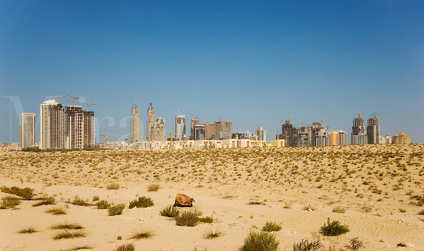 Dubai rises from the desert.  Skyline looking across the desert towards the Greens community..