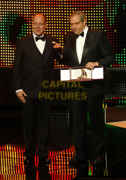 PRINCE ALBERT II OF MONACO & DICK WOLF.At the Golden Nymph awards ceremony during the 2008 Monte Carlo Television Festival held at Grimaldi Forum, Monte Carlo, Principality of Monaco, .June 12, 2008..full length black tuxedo bow ties on stage show.CAP/TTL.©TTL/Capital Pictures