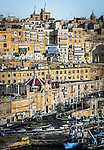 Late afternoon light illuminates Valletta in Malta.