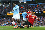 Chris Smalling of Manchester United blocks an attempted shot on goal from Wilfried Bony of Manchester City during the Barclays Premier League match at the Etihad Stadium. Photo credit should read: Philip Oldham/Sportimage