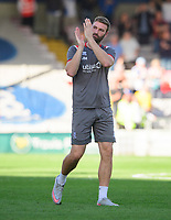Lincoln City's first team coach Jamie McCombe applauds the fans at the final whistle<br /> <br /> Photographer Chris Vaughan/CameraSport<br /> <br /> The EFL Sky Bet League One - Lincoln City v Bristol Rovers - Saturday 14th September 2019 - Sincil Bank - Lincoln<br /> <br /> World Copyright © 2019 CameraSport. All rights reserved. 43 Linden Ave. Countesthorpe. Leicester. England. LE8 5PG - Tel: +44 (0) 116 277 4147 - admin@camerasport.com - www.camerasport.com