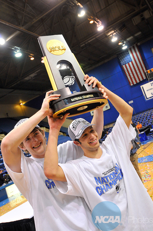 21 MAR 2009: Washington University - St. Louis guard Sean Wallis (front) and teammate Caleb Knepper celebrate with the National Championship trophy after winning the 2009 NCAA Division III Men's Basketball Championship held at the Salem Civic Center in Salem, VA. Washington University - St Louis defeated Richard Stockton College College 61-52 to win their second national title game in a row. Andres Alonso/NCAA Photos