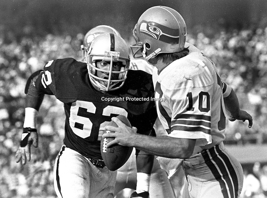 Oakland Raider lineman Reggie Kinlaw puts rush on Seattle quarterback Jim Zorn. (1979 photo/by Ron Riesterer)