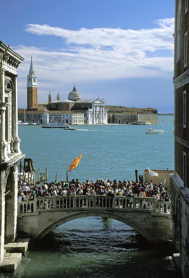 Election supporters rally for their party on Saint Giorgio Maggiore (viewed from Bridge of Sighs), Venice, Italy
