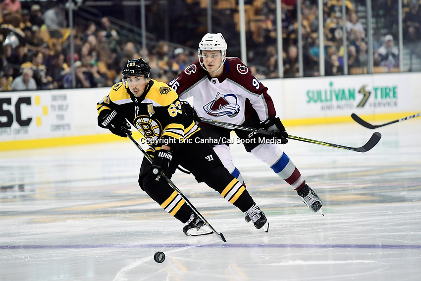 Boston Bruins left wing Brad Marchand (63) and Colorado Avalanche right wing Mikko Rantanen (96) in game action during the NHL game between the Colorado Avalanche and the Boston Bruins held at TD Garden, in Boston, Mass. Colorado defeats Boston 4-0. Eric Canha/CSM