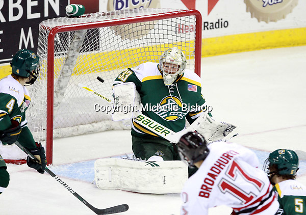 Nebraska-Omaha's Terry Broadhurst fires the puck past Alaska-Anchorage goalie Rob Gunderson. (Photo by Michelle Bishop) .